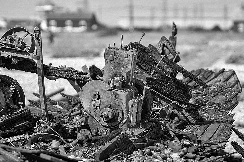 the remains of a burned out fishing boat on dungeness Beach