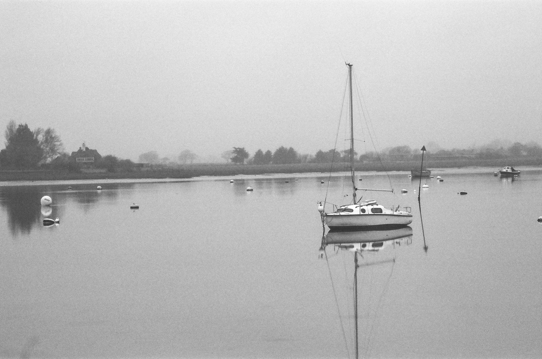 Sailing boat at Bosham at high tide